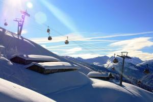 Brixental Winter Schnee Gondel Lift Hütte ALDI SUISSE TOURS